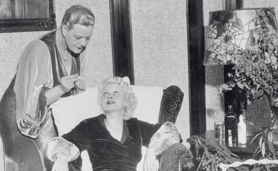 Mother Nurses Jean Harlow taking Jean Harlow's temperature