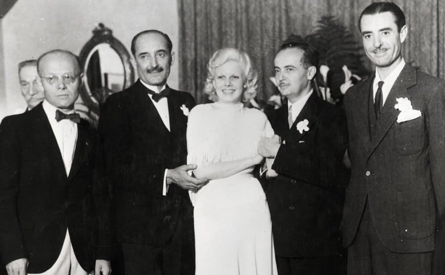 Jean Harlow at marriage to Paul Bern, film executive, 1932 with stepfather Count Bello and best man, John Gilbert.