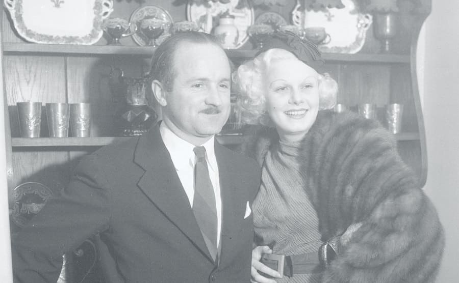 Jean Harlow, platinum blonde film beauty, and her husband, Harold Rosson, shown as they attended the Christmas Day party given by Colleen Moore.