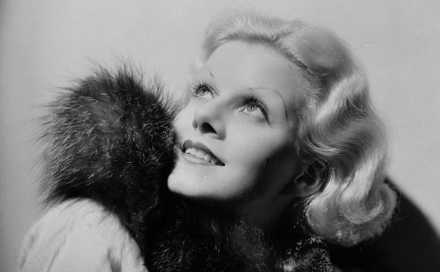 American film star Jean Harlow dressed in furs.