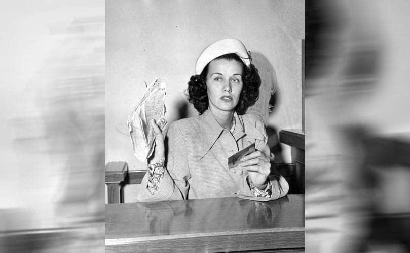 Jean Spangler in court showing off a handful of documents