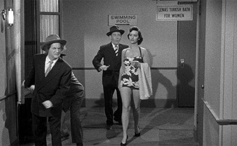 Jean Spangler walking down a hall with the Three Stooges in the film Mummy's Dummies