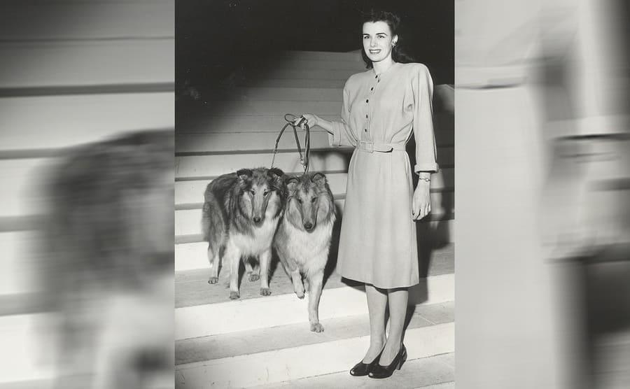 Jean Spangler walking two dogs