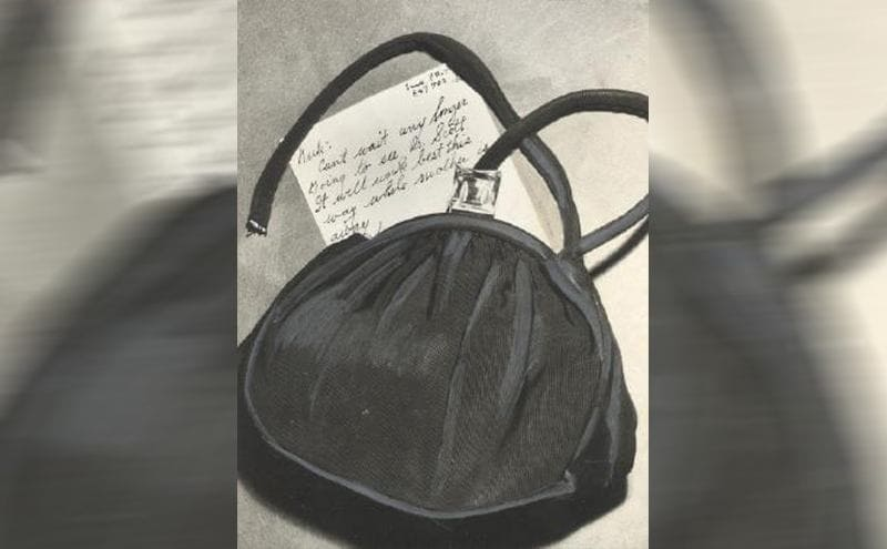 The ripped purse with the note sticking out of it