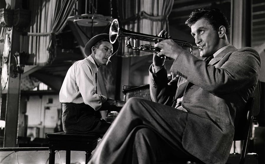 Hoagy Carmichael and Kirk Douglas playing the trumpet in a scene from Young Man With A Horn