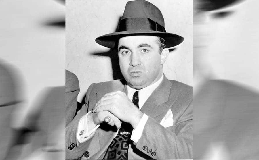 Mickey Cohen posing with his hands together