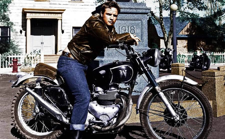Marlon Brando posing on a motorcycle for the film The Wild One