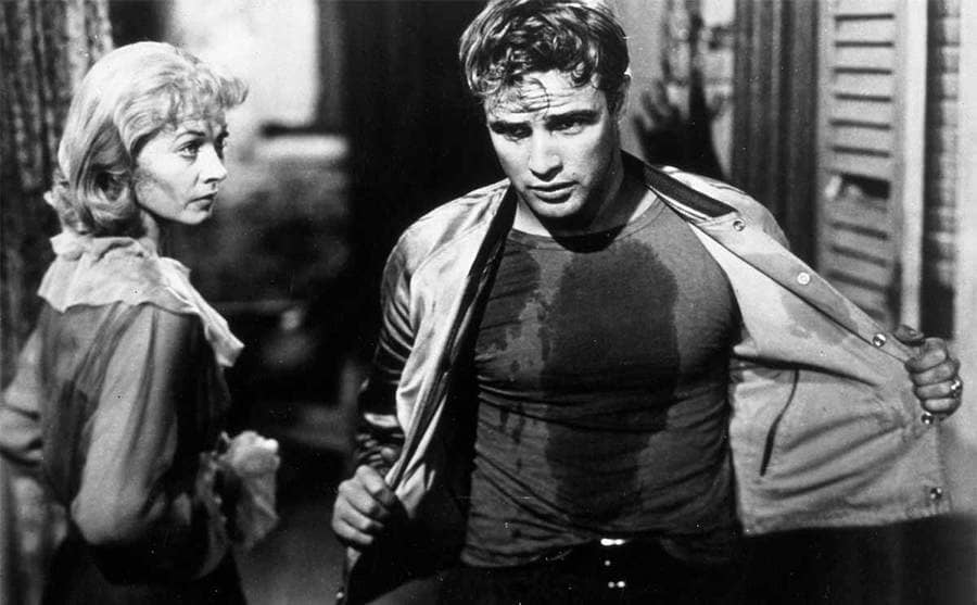 Marlon Brandon sweating and removing his jacket in the film Streetcar Named Desire 1951