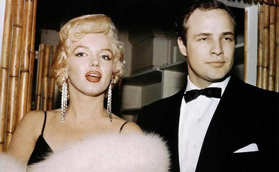 Marilyn Monroe and Marlon Brando posing together circa 1955