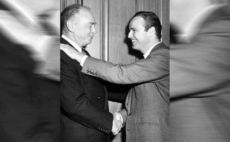 Marlon Brando shaking his father's hand