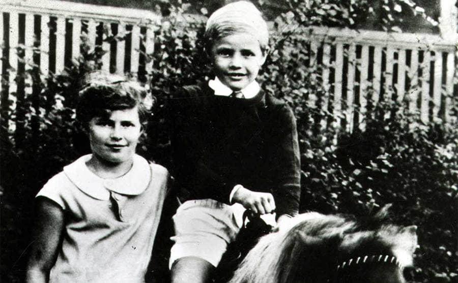 Marlon Brando riding a horse as a young boy