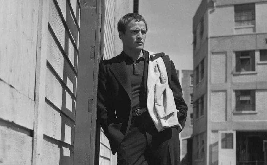 Marlon Brando leaning against a building