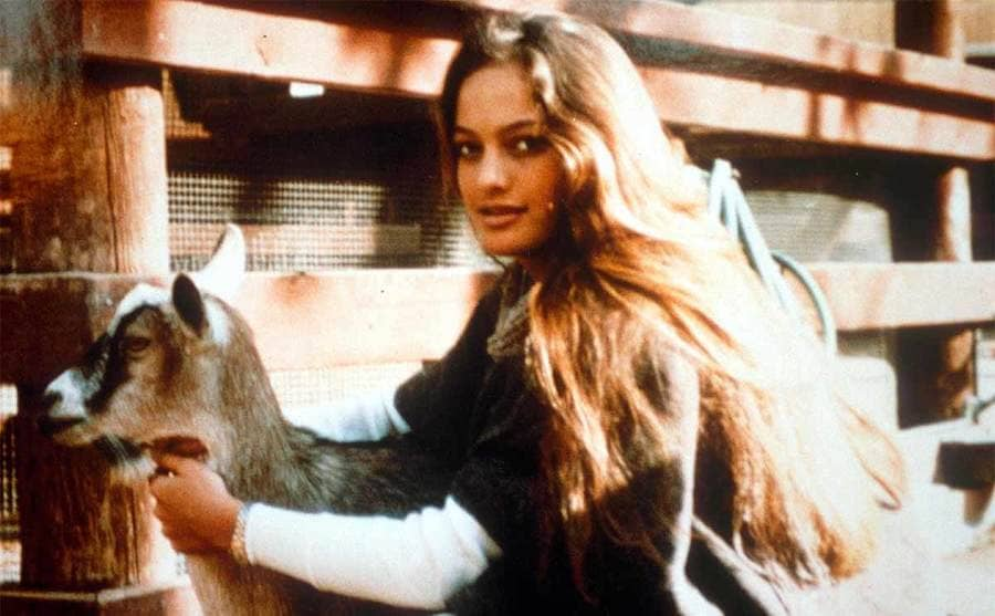 Cheyenne Brando petting a goat at the family home 1990