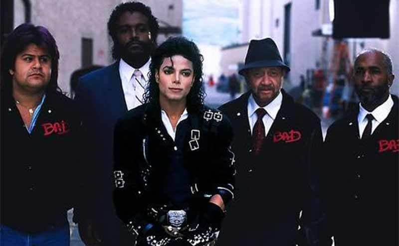 Michael Jackson with his bodyguards