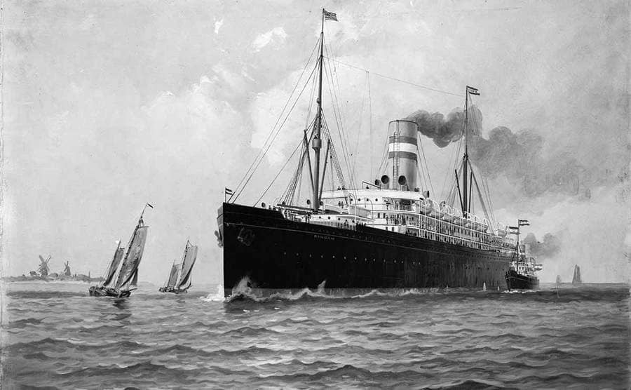 A steamship in the water with small sailboats around it
