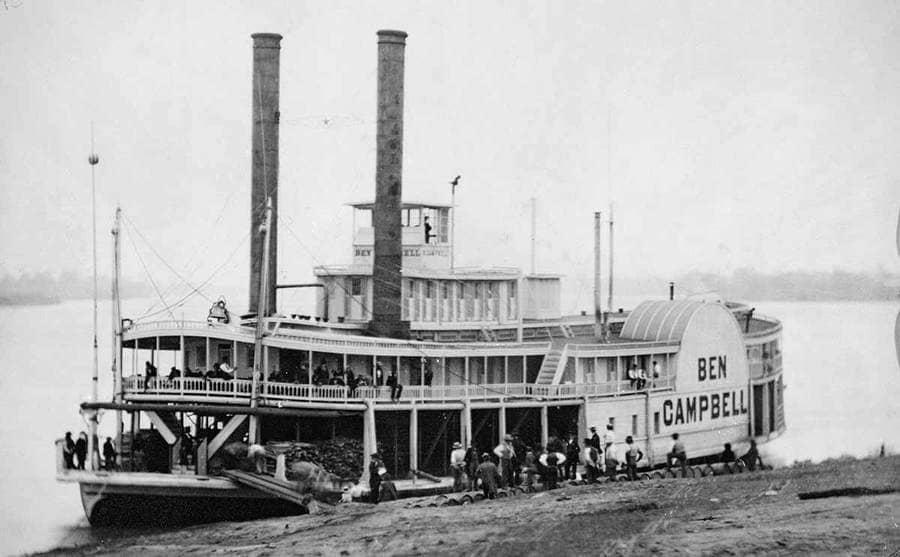 People boarding a steamship