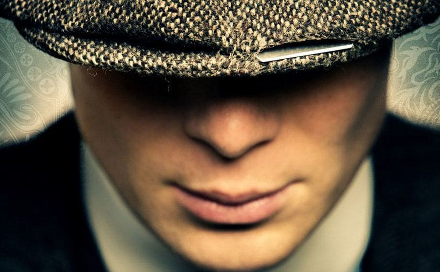 A razor blade peeking out of Cillian Murphy's flat hat as part of a poster for the new season.