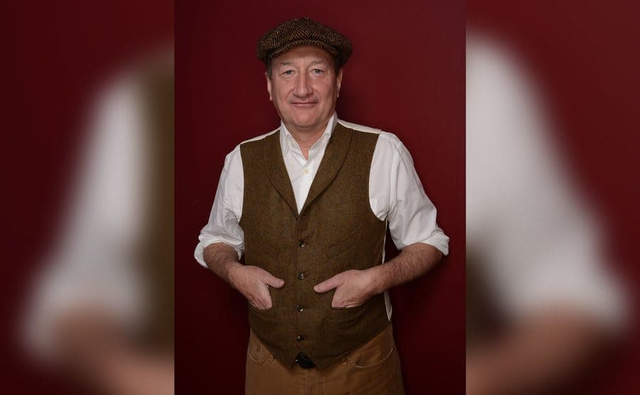 Filmmaker Steven Knight poses for a portrait during the 2014 Sundance Film Festival dressed in 'Peaky Blinders' stay clothing and hat.