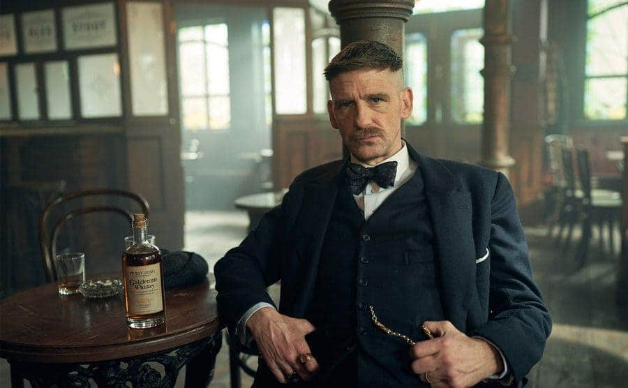 Arthur Shelby played by Paul Anderson sitting in the bar.
