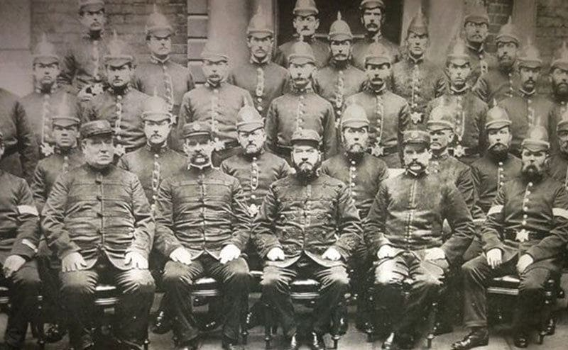 Police officers pose for a group photo.