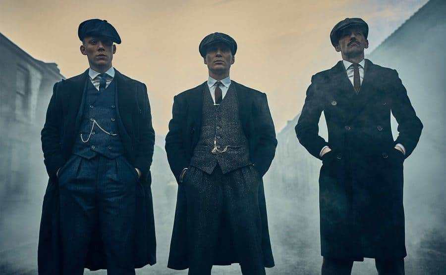 Tommy Shelby, Arthur Shelby and John Shelby standing on the street.