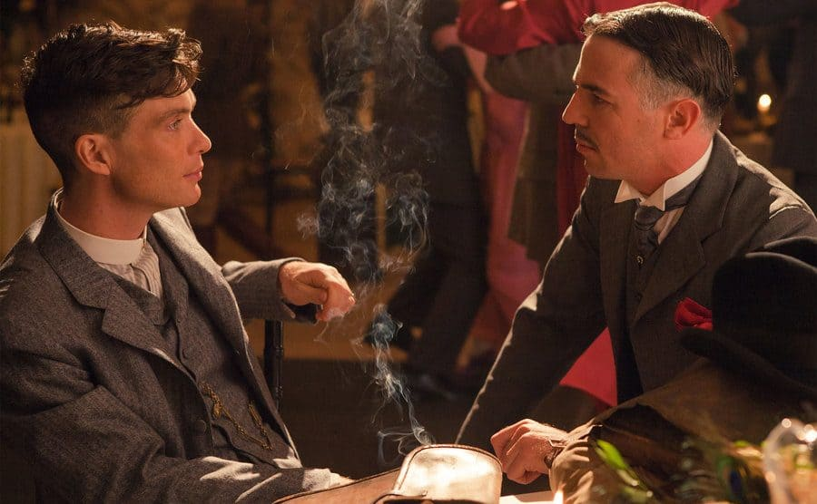 Tommy Shelby and Billy Kimber sit down in the nightclub.
