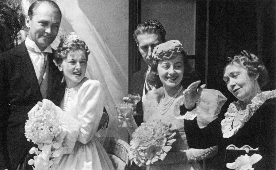 Brian Aherne, Joan Fontaine, Olivia de Havilland, and their mother on Joan's wedding day.