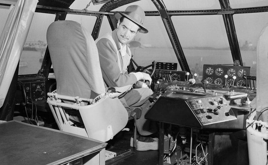 Howard Hughes prepares in the cockpit for the historic flight of the Spruce Goose.
