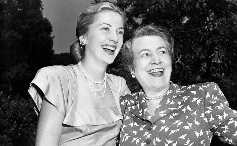 Joan Fontaine with her mother in the backyard.