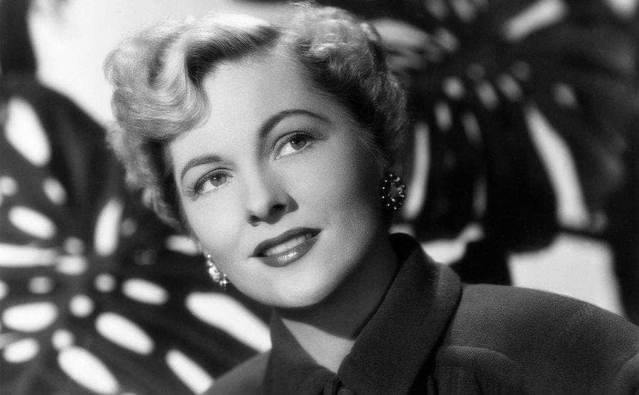 Actress Joan Fontaine posed for a portrait with her bleach blond hair.