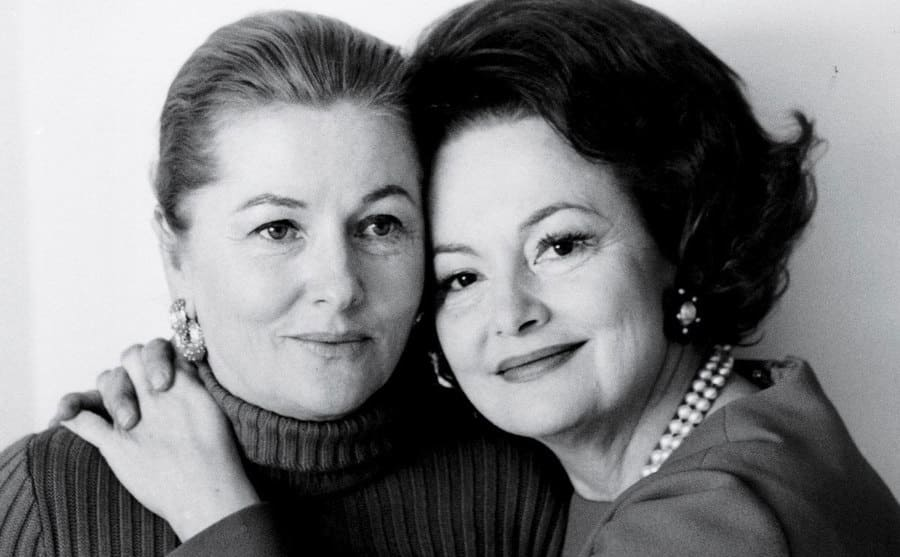 Joan Fontaine and Olivia de Havilland, in their old age, embracing one another.