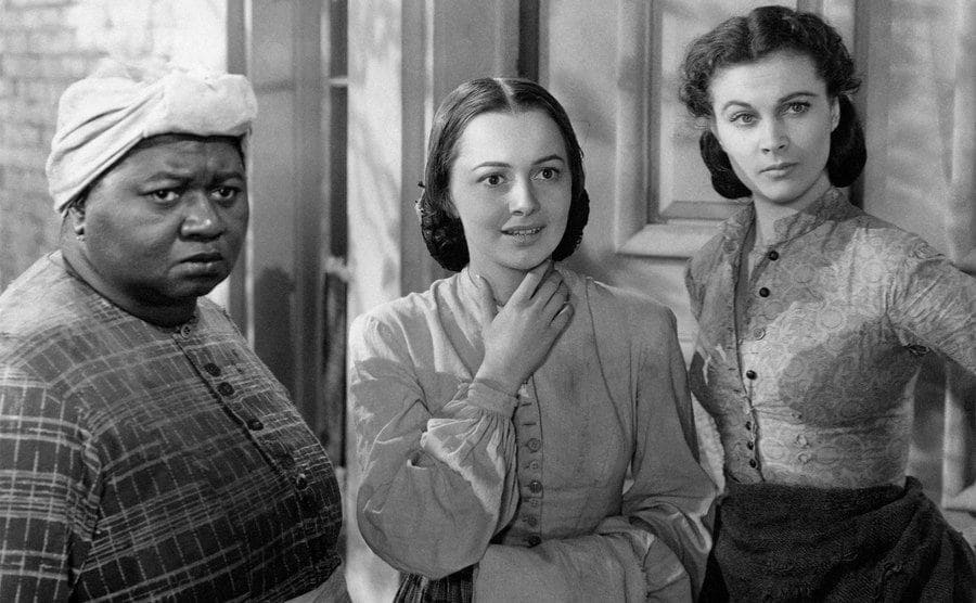 Actresses Vivien Leigh, Olivia De Havilland and Hattie McDaniel, play Scarlett O'Hara, Melanie Hamilton and Mammy, respectively in a scene from the movie Gone with the Wind.