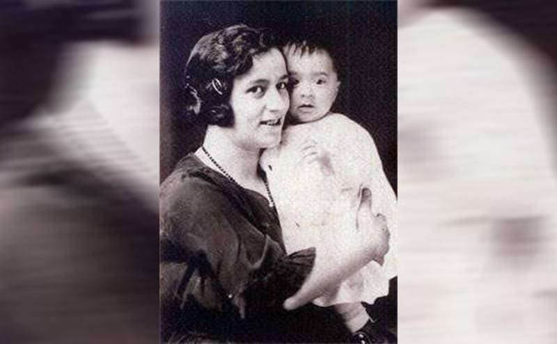 A portrait of Jennie Sodder holding her eldest son, John