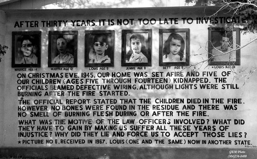 A newer billboard with the photographs of the missing Sodder children with information about the night of the fire and conspiracies