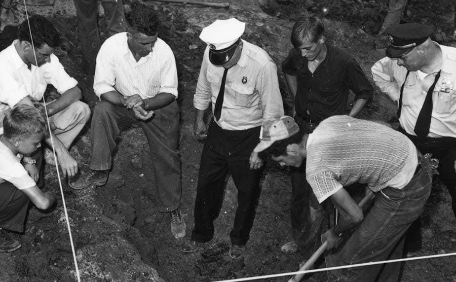 Men performing an excavation on the Sodder house remains