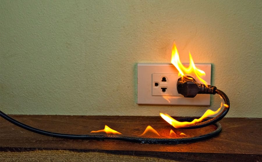 An electrical wire on fire while plugged in