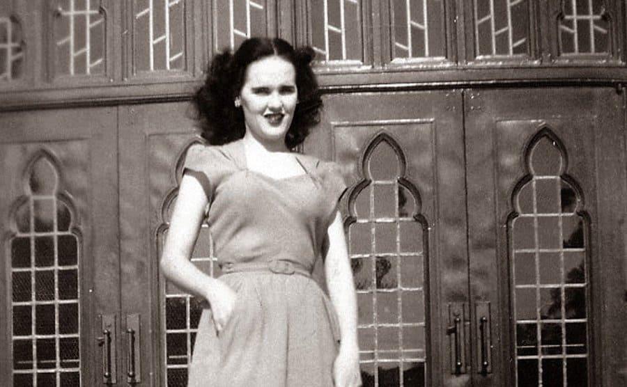Elizabeth on the front steps of a large building.