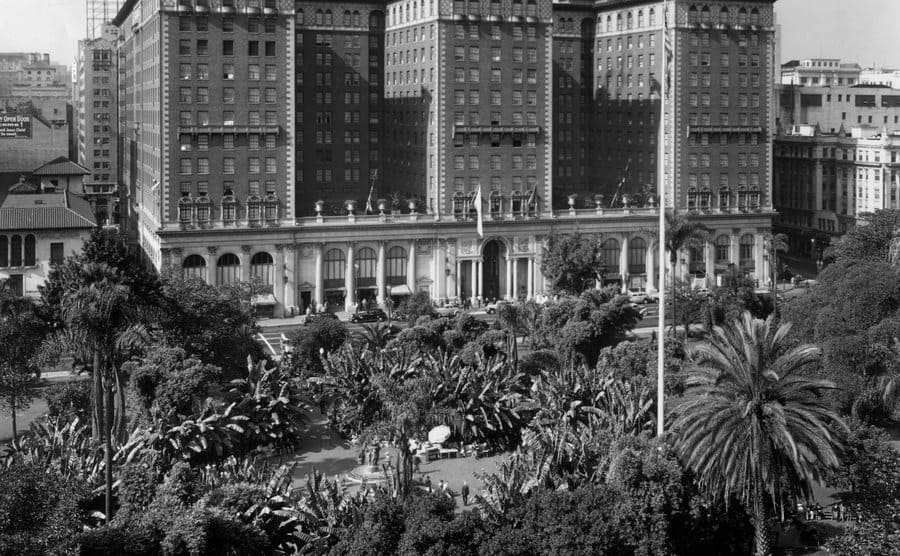 Looking west over the palms and banana trees of Pershing Square to the Biltmore Hotel.