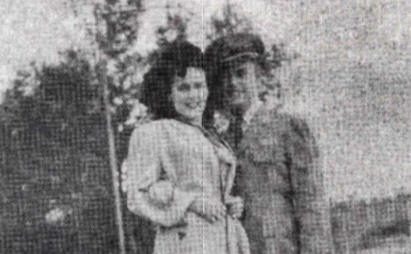 A photo of a smiling happy Elizabeth out with some man.