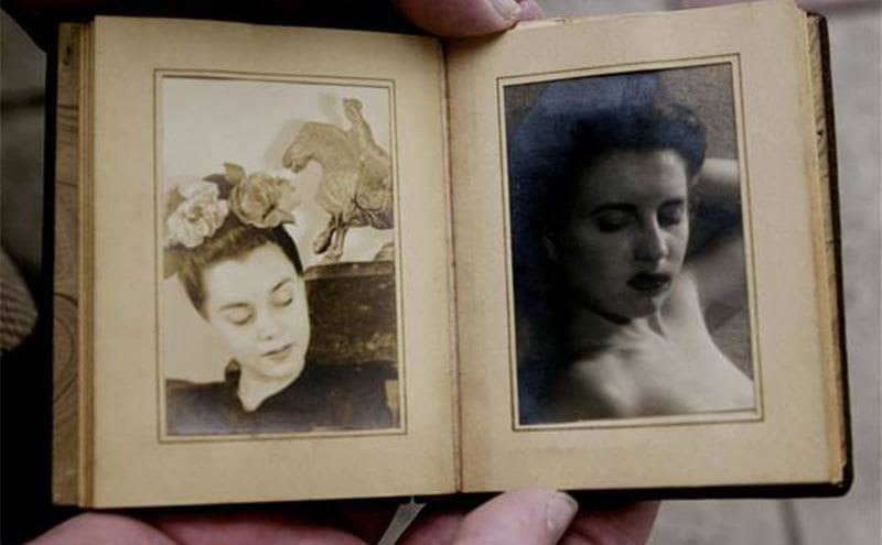 A small photo album with pictures of Elizabeth Short.