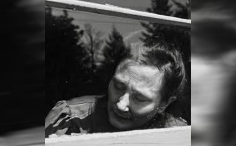 Mary Mallon sitting behind a closed window