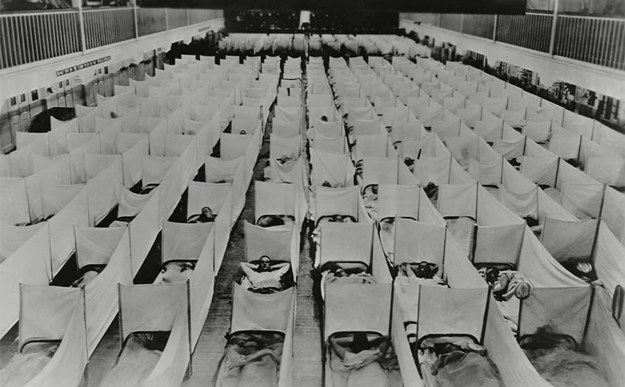 An overflowing floor with hundreds of beds containing flu patients