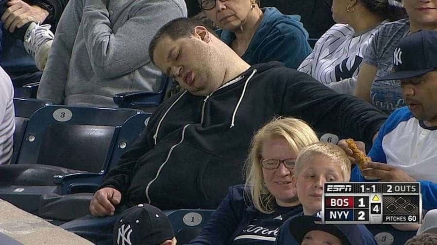 Photograph of the shot that ESPN captured of Andrew Rector sleeping in the stands.