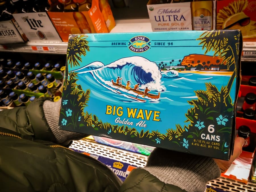 A six-pack of cans of Kona Brewing Co's beer in a supermarket.