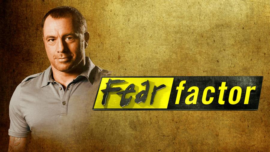 Photograph of the Fear Factor logo with the host Joe Rogan.