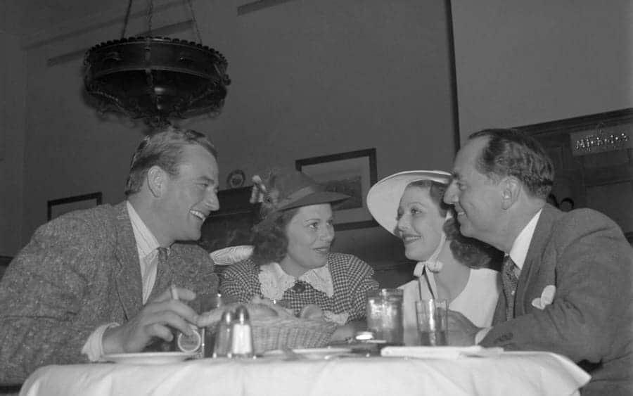 Mr. and Mrs. John Wayne, Loretta Young, and William Powell