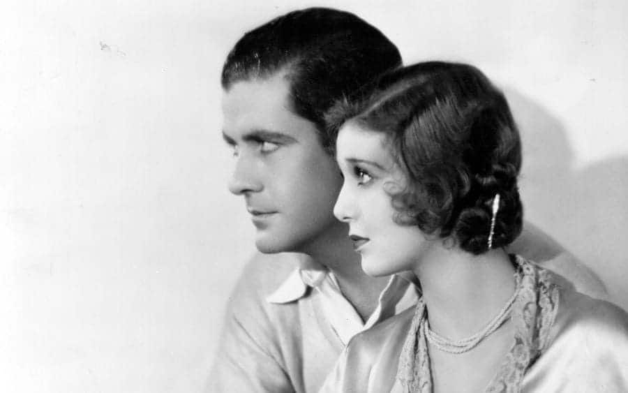 American actress Loretta Young sitting close by Grant Withers.