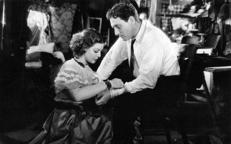 Loretta Young tending to Spencer Tracy's arm in a scene from the film 'Man's Castle'