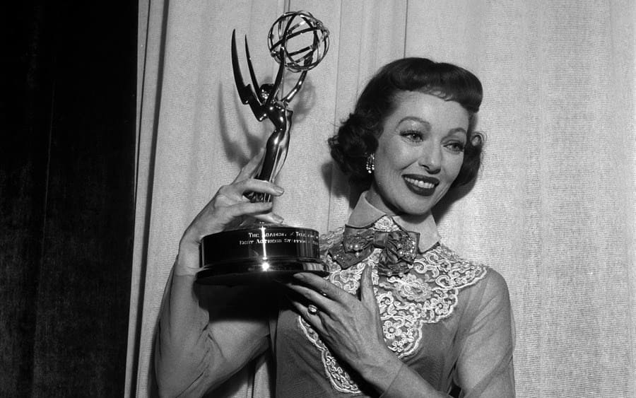 Actress Loretta Young poses with her Emmy Award for