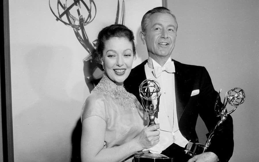 Loretta Young and Robert Young pose with their Emmy Awards.